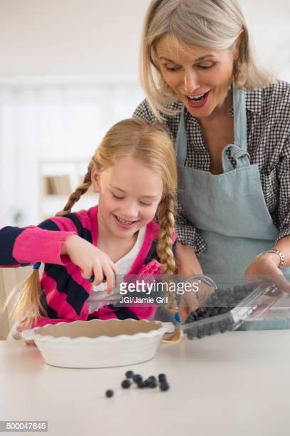 Senior Caucasian woman and granddaughter baking together