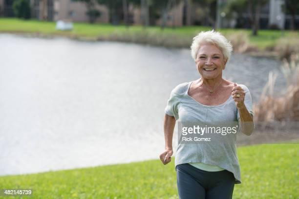 Senior Caucasian woman jogging in park