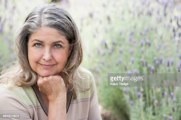 Senior Caucasian woman relaxing outdoors