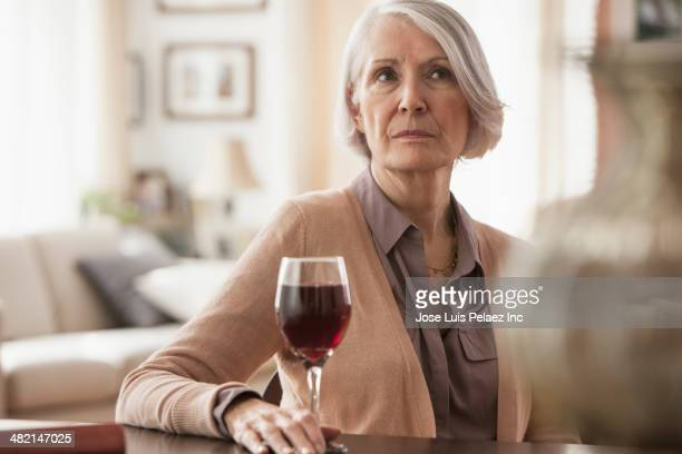Senior Caucasian woman with glass of wine