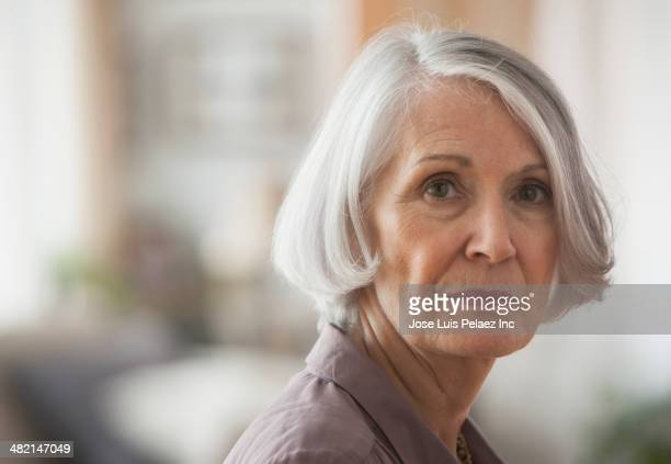 Senior Caucasian woman's serious face