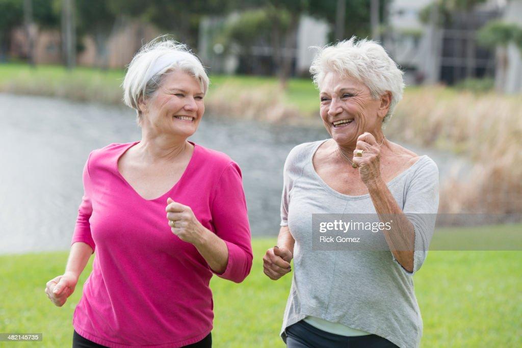 Senior Caucasian women jogging in park : Stock Photo