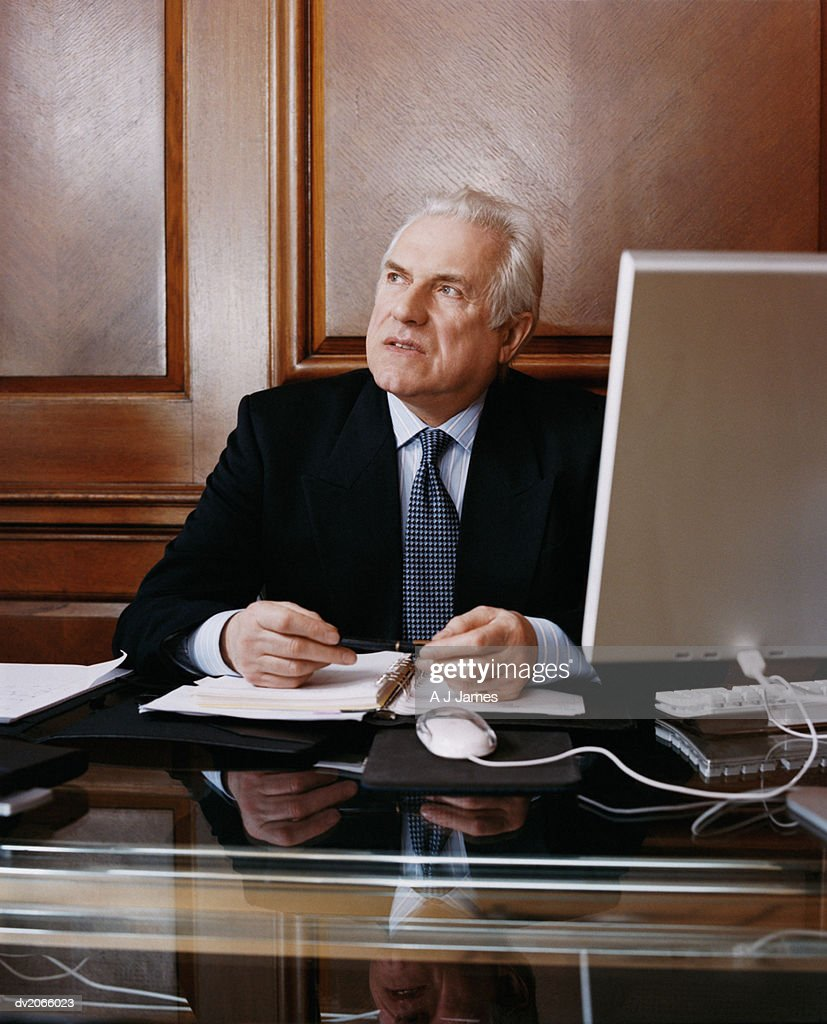 Senior CEO Sitting at His Desk : Stock Photo