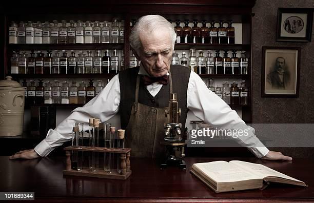 Senior chemist working in antiquated lab
