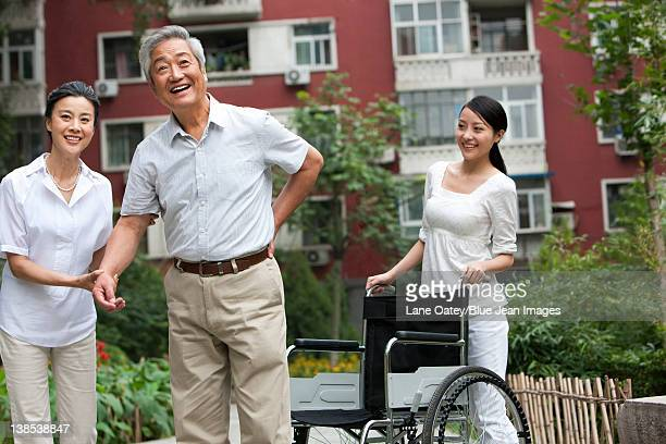 Senior Chinese couple with adult daughter