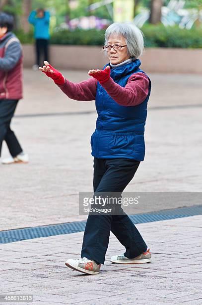 Senior Chinese woman practising Tai Chi Hong Kong