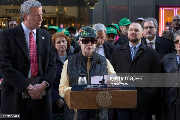 Senior citizen Adriana speaks at rally against GOP tax bill in front of Trump Tower on 5th Avenue