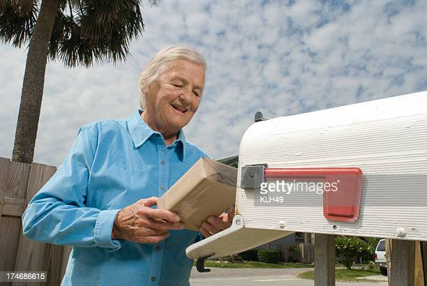 Senior Citizen at mailbox