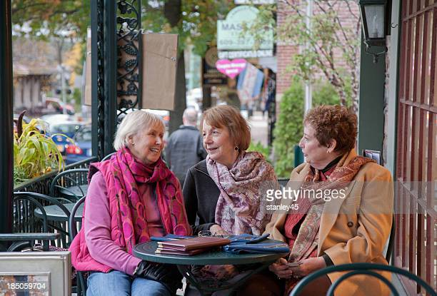 Senior Citizen friends having lunch together