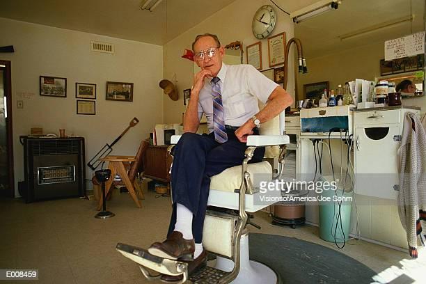 Senior citizen gentleman sitting in barber's chair