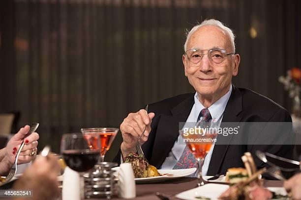 Senior Citizen man enjoying her dining experience.