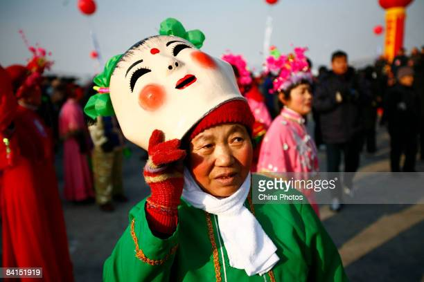 A senior citizen performs Yangko a traditiional rural folk dance during a a New Year's Day celebration at the Nanhu Park on January 1 2009 in...