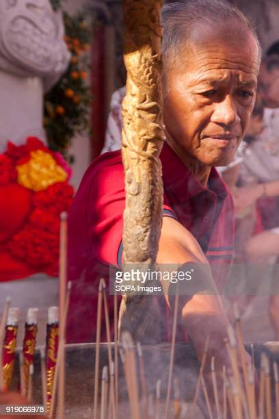 A senior citizen seen burning incense stick at the Thean Hou Temple on the first day of Chinese New Year Chinese New Year is the first day of the New...