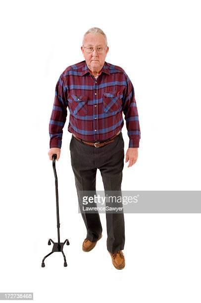 Senior cidadão com um Bastão quad