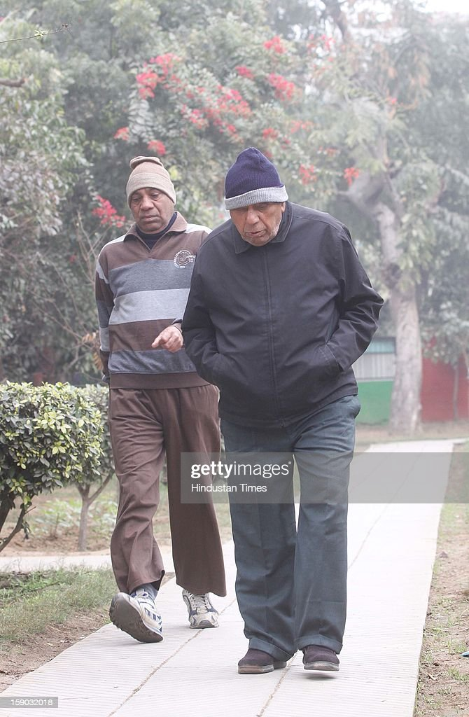 A senior citizen walk in a cold morning at a park on January 6, 2013 in Gurgaon, India. Setting a new low for temperature this winter, mercury in the national capital on Sunday fell to 1.9 degrees Celsius - five notches below average. This is the lowest recorded in North India in five years.