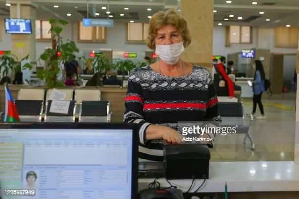 Senior citizen wearing a protective facemask inside ASAN service in Baku on May 20 2020 in Baku Azerbaijan The coronavirus outbreak has infected more...