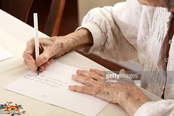 Senior Citizen Writing a Note