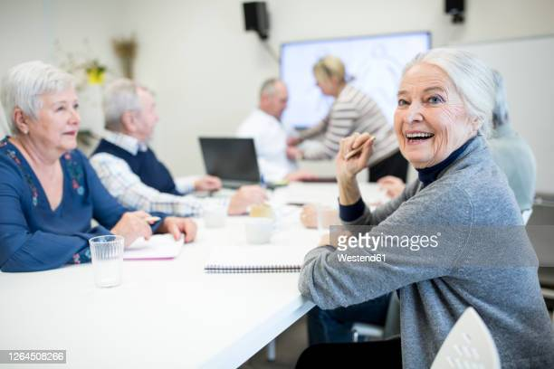 senior citizens attending public health course - attending stock pictures, royalty-free photos & images