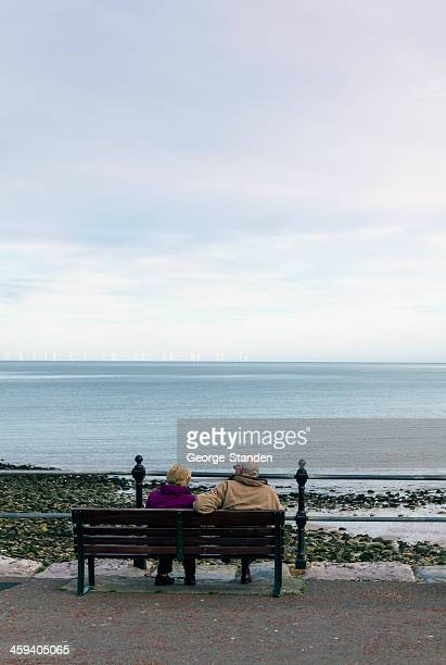 Senior Citizens couple looking out to sea, Llandudno