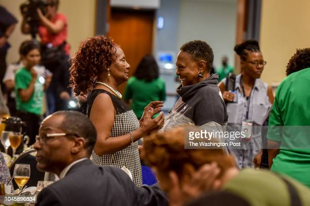 Senior citizens displaced by the devastating fire at the Arthur Capper Senior Apartments attend a luncheon hosted by DC Mayor Muriel Bowser at Walter...