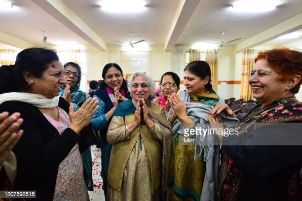 Senior citizens greet each other in different ways as the scare of coronavirus, on March 7, 2020 in New Delhi, India. The virus has spread to more...