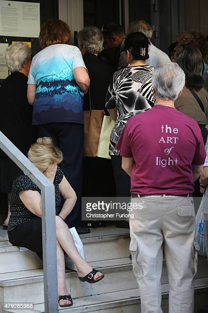 Senior citizens line up outside a National Bank branch to collect their pensions on July 3 2015 in Athens Greece The 'Yes' and 'No' supporters in...