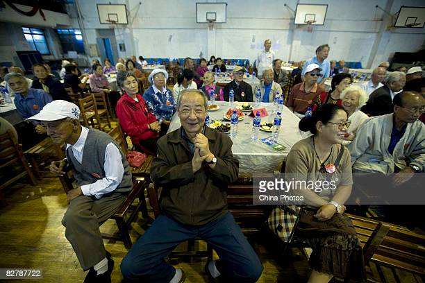 Senior citizens of golden or silver wedding attend a collective celebration of their wedding anniversary on September 12 2008 in Changchun of Jilin...