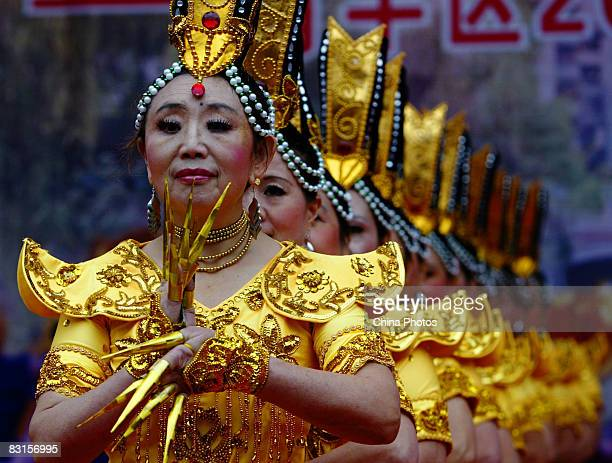 Senior citizens of the over60s give a performance of the 'Thousandhand Goddess of Mercy' to celebrate this year's Chongyang Festival on October 7...