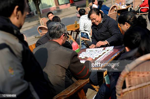 Senior citizens play mahjong in the ancient Lizhuang Township on December 19 2010 in Yibin Sichuan Province China Lizhuang Township dates back over...