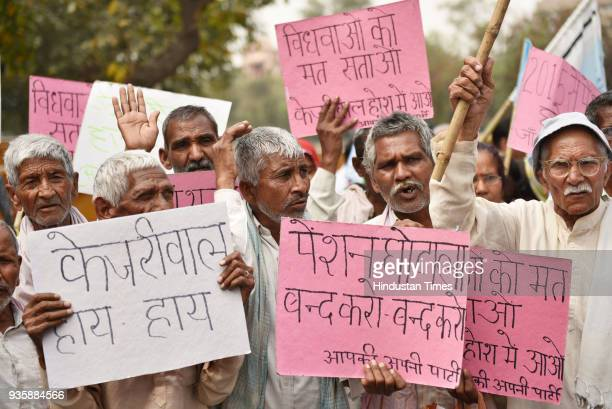 Senior citizens protesting against the delayed payment of pension from a long time calling it as a Scam during a protest march at Civil Lines on...