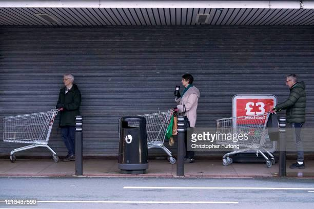 Senior citizens queue to shop at Sainsbury's Supermarket on March 19 2020 in Northwich United Kingdom A queue of approximately 600 old age pensioners...
