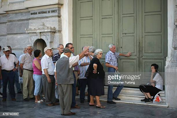 Senior citizens queue up to collect their pensions outside a National Bank of Greece branch in Kotzia Square on July 7 2015 in Athens Greece Greek...