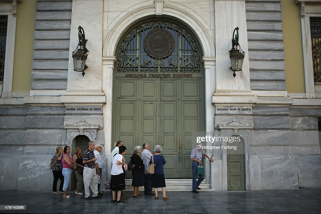 Senior citizens queue up to collect their pensions outside a National Bank of Greece branch in Kotzia Square on July 7, 2015 in Athens, Greece. Greek Prime Minister Alexis Tsipras is working on new debt crisis proposals and is due to present them at a Eurozone emergency summit today.