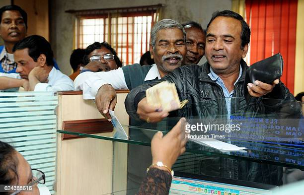Senior citizens solving their currency relegated works at cash counter of a bank after senior citizens are exempted as legal tender by government...