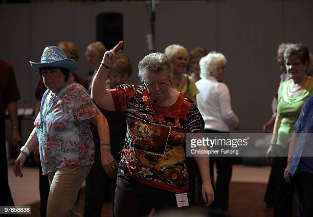 Senior citizens take part in a dance keep fit session as they attend the The Retirement Show at Manchester Central on March 19, 2010 in Manchester,...
