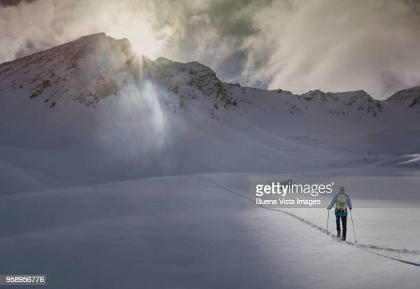 Senior climber on a snowy slope