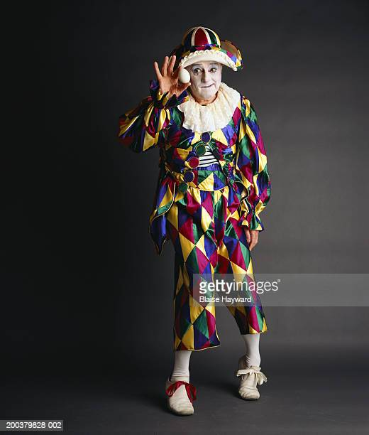 Senior clown holding egg, portrait