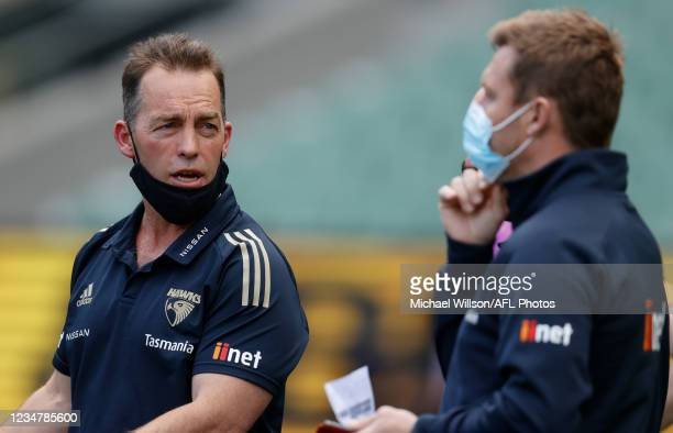 Senior coach Alastair Clarkson and Head of Development Sam Mitchell of the Hawks share a discussion during the 2021 AFL Round 23 match between the...