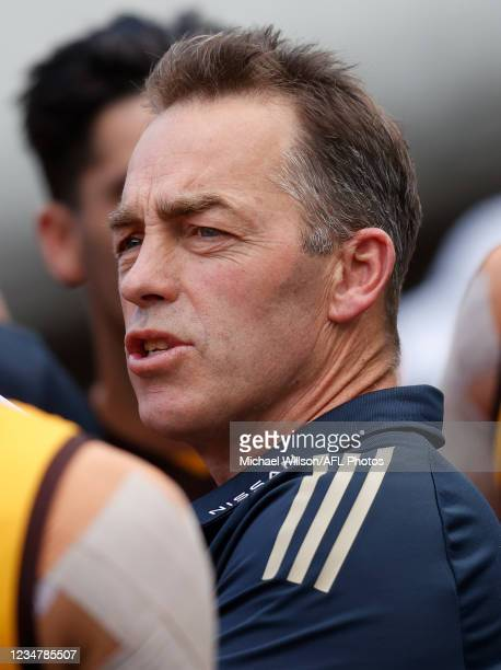 Senior coach Alastair Clarkson of the Hawks delivers his final address to players at three-quarter time during the 2021 AFL Round 23 match between...