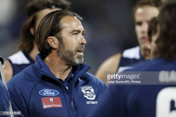 Senior coach Chris Scott of the Cats addresses his players during the 2021 AFL Round 05 match between the Geelong Cats and the North Melbourne...