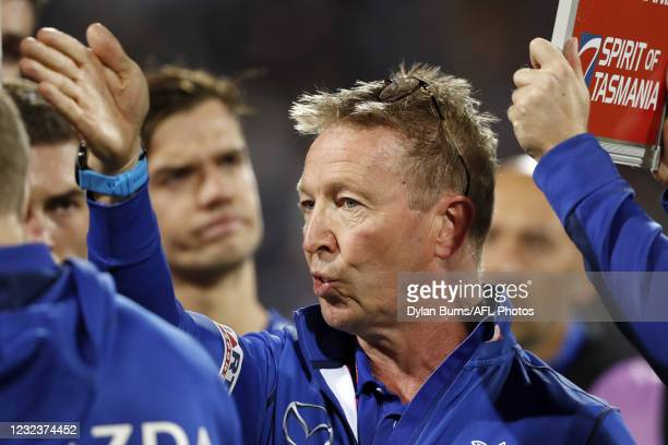 Senior coach David Noble of the Kangaroos addresses his players during the 2021 AFL Round 05 match between the Geelong Cats and the North Melbourne...