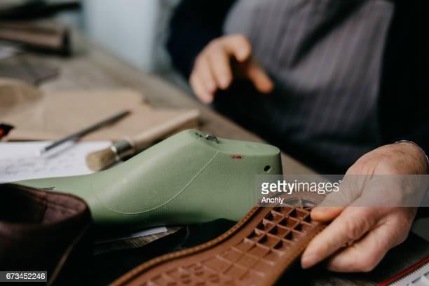 Senior cobbler making handmade shoes