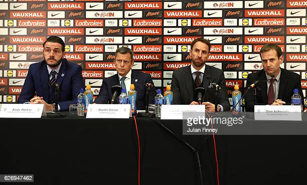 Senior Communications Manager Andy Walker FA Chief Executive Martin Glenn and FA Technical Director Dan Ashworth look on as Gareth Southgate speaks...