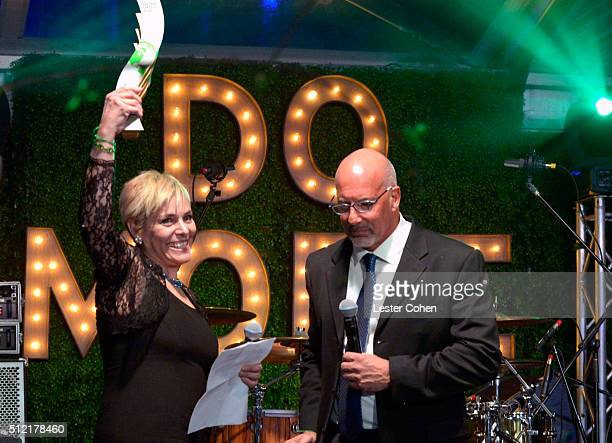 Senior communications officer of the World Bank Lucia Grenna accepts award from president CEO Global Green USA Les McCabe onstage during Global Green...