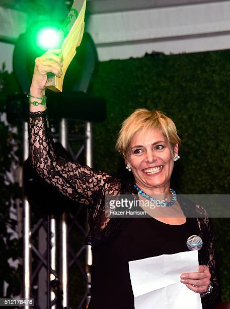 Senior communications officer of the World Bank Lucia Grenna accepts award onstage during Global Green USA's 13th annual preOscar party at Mr C...