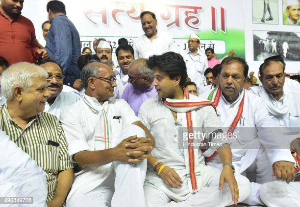 Senior Congress leader Digvijaya Singh joins Jyotiraditya Scindia on his 72hour Satyagraha for farmers on June 15 2017 in Bhopal India