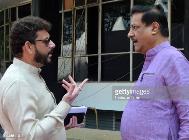 Senior Congress leader Prithviraj Chavan interacts with AIMIM MLA Waris Pathan during budget session at Mantralaya on March 8 2018 in Mumbai India...