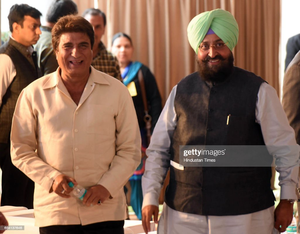 Senior congress leaders Raj Babbar and Partap Singh Bajwa during Capt Amrinder Singh oath ceremony The oath was administered by Punjab Governor VP...