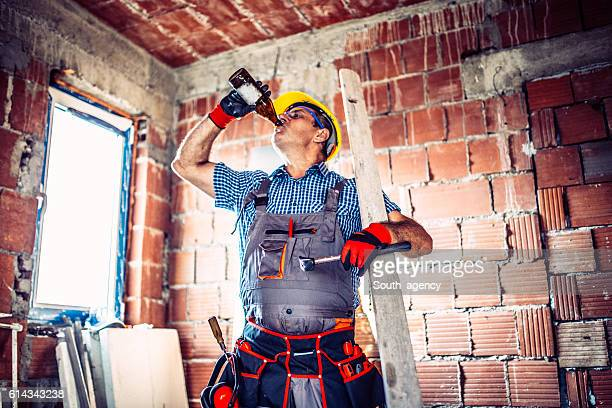 Senior construction worker relaxing