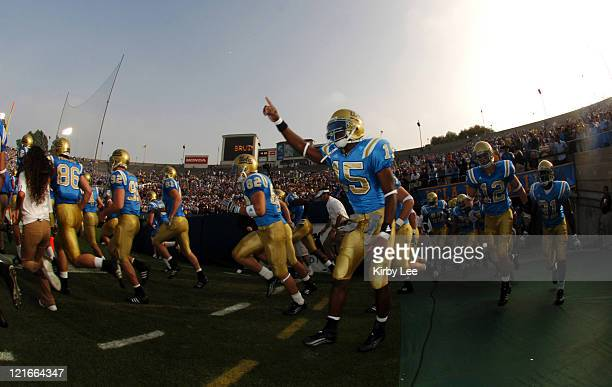 Senior cornerback Marcus Cassel runs onto the field with Bruin teammates before 51-28 victory over Oregon State in Pacific-10 Conference football...